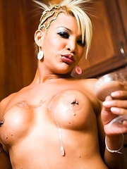 Blonde Asian Shemale dips her cock and balls in chocolate