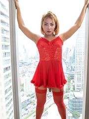 Ladyboy Ning in red stockings bareback