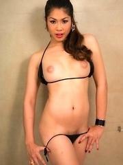 Wet black bikini pulled side for Ladyboy Sakura pleasure