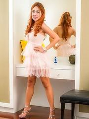 Upskirt of lovely Ladyboy Nongs spread hole in a girlfriend dress